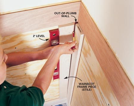 <b>Photo 5: Wainscoting</b></br> Fit a board to a corner that's not plumb. Use a level to hold the board plumb. Set the compass for the widest gap and scribe the line. Saw or plane away the wood to the outside of the line.