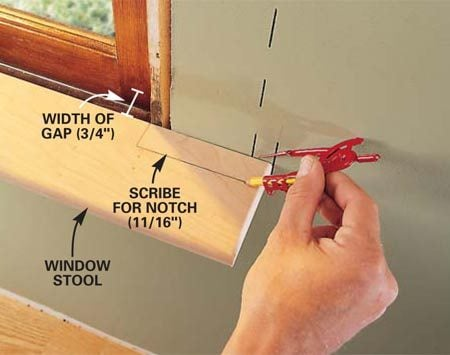 <b>Photo 7: Window stools</b></br> Notch your window stool and set it in place. Measure the gap between the back edge of the stool and the window and set your compass for 1/16 in. less than this measurement. Run your compass along the wall behind each end of the stool. Saw or file away the material to the lines.