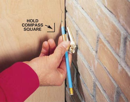 <b>Photo 8: Irregular edges</b></br> Scribing helps you fit a cabinet side, paneling or molding to irregular surfaces like brick. First support the paneling or molding so its edge is plumb. Then set the compass a little wider than the widest gap and scribe the line. Be careful to hold the compass perpendicular to the surface being scribed.
