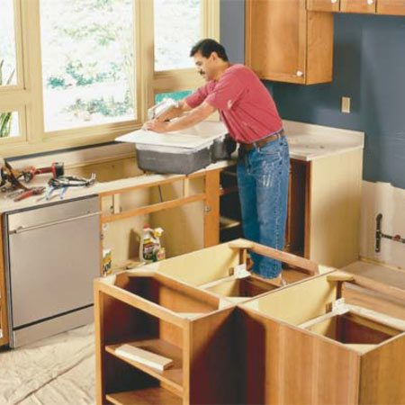 <b>Photo 1: Getting started</b></br> Move aside stoves and refrigerators and pull the kitchen sink before removing the countertops. Then remove all of the lower cabinet drawers and doors and cabinet contents.