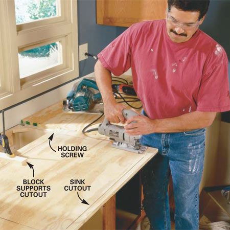 <b>Photo 5: Cut out the opening for the sink</b></br> Lay out the sink opening following the manufacturer's  template or instructions and cut the opening with a jigsaw (careful, don't  wreck the cabinet fronts). Use a clamp and a block of wood to support the  cutout until you finish the cut.