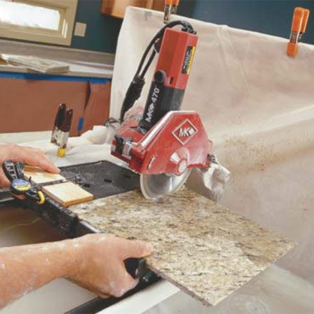 <b>Photo 10: Cut nosing strips</b></br> Cut miters on opposite edges of two tiles, then remove the jig and cut two 2-in. wide nosing strips off one of the tiles. Use the full tile and one of the nosing strips to check fits and lay out the tile pattern.