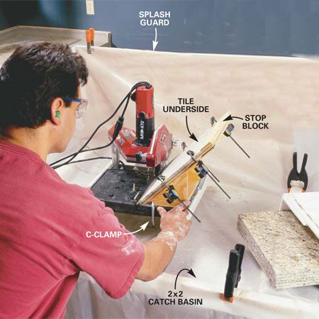 <b>Photo 9: Make cuts using your mitering jig</b></br> Set up your mitering jig  (see Fig. B) and cut a sample nosing piece and a countertop tile for the tile layout. Clamp the jig so the blade cuts just shy of the factory micro-bevel. Make a test cut, then remove the tile and make sure the bevel is even. Adjust the jig and re-cut if necessary.