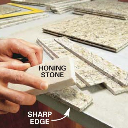 <b>Photo 13: Ease sharp edges</b></br> Use a honing stone to ease sharp edges that'll be exposed.