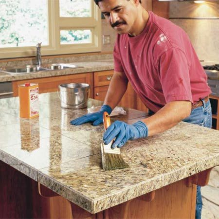 <b>Photo 19: Seal the grout</b></br> Install your sink and other appliances to get your kitchen back in service. Let  the grout cure for a week or so, then seal it with a product that's designed  specifically for polished granite. Follow the directions on the container.