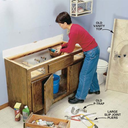 <b>Photo 1: Remove the old vanity</b></br> Disconnect the trap and supply lines to the sink and pry off the vanity top. Locate and remove the nails or screws that hold the cabinet to the wall and remove the vanity cabinet.