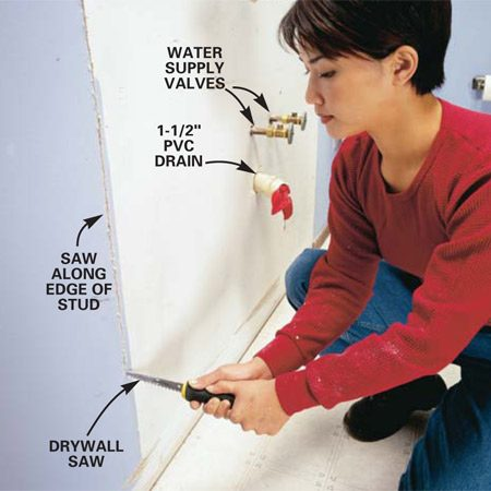 <b>Photo 2: Cut open the wall</b></br> Saw  along the edge of the studs on both sides of the drain to at least 48 in. high. Tear off the drywall in this area.