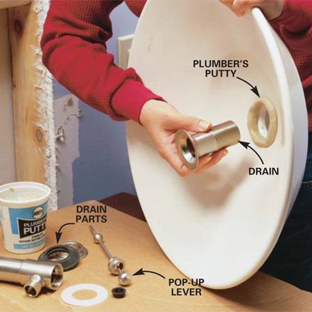 "<b>Photo 4: Set the drain</b></br> Roll a ball of plumber's putty between your hands to form a putty ""snake."" Press the putty around the drain opening. Slide the top of the drain assembly through the drain hole and press it into the putty. Install the rubber washer, plastic washer and nut and tighten carefully until the drain is secure and flush with the bowl."