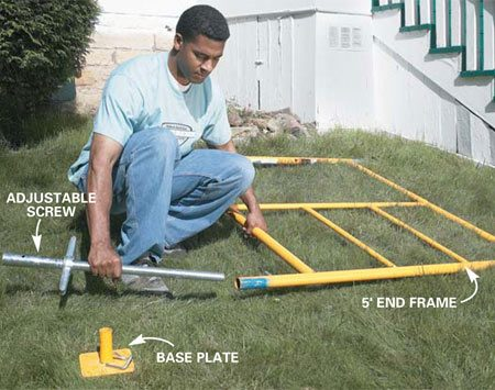 <b>Photo 1: Assemble the base parts</b></br> Begin assembly by laying two end frames about 7 ft. apart, near your worksite. Slide on the adjusting  screws and base plates or casters now so you don't have to lift the entire scaffolding later to put them in.