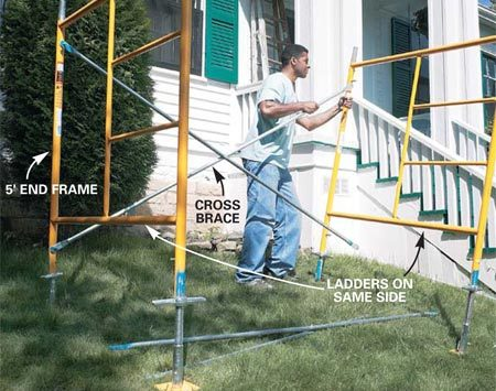 <b>Photo 3: Install cross braces</b></br> Stand one end frame and slide the crossbar ends over the pins. Rest the cross brace on the ground to temporarily support the first end frame while you move the other one into position. Tip the second frame up and slip the opposite end of the cross brace over the pins in the second scaffold frame. Complete the frame setup by attaching the second cross brace on the opposite side.