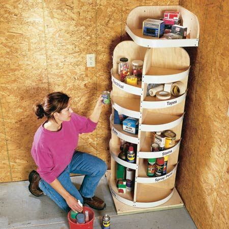<b>Rotating corner shelves</b></br> These shelves put a garage corner to maximum storage use. They spin on two lazy Susans, one on the bottom and one at the top (under the top shelf). They can't tip because the top shelf is screwed to the wall.