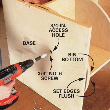 <b>Photo 5: Screw the base assembly to the shelves</b></br> Center the base on the bin bottom and align a screw hole in the top ring of the lazy Susan with the access hole. Fasten the top ring of the lazy Susan to the bin bottom with a 3/4-in. No. 6 flat head screw driven through the access hole. Turn the bin bottom to align the remaining screw holes in the top ring with the access hole, and fasten with additional screws.