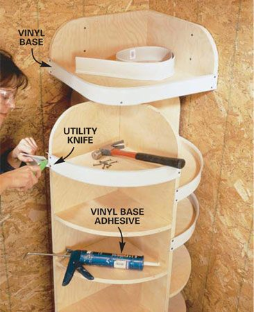 <b>Photo 9: Mount the vinyl edging</b></br> Squeeze a 3/8-in. bead of cove base adhesive along the shelf edges. Position the vinyl base with the lip to the top, curling out. Secure the ends with 1 in. tacks. Trim the ends flush with a utility knife.