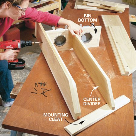 <b>Photo 5: Assemble the box</b></br> Predrill and screw the center divider to the bin bottom with 2-1/4 in. trim head screws. Then add the sides, bottom, and top. Next attach the back and the top half of the cleat with 1-1/4 in. screws.