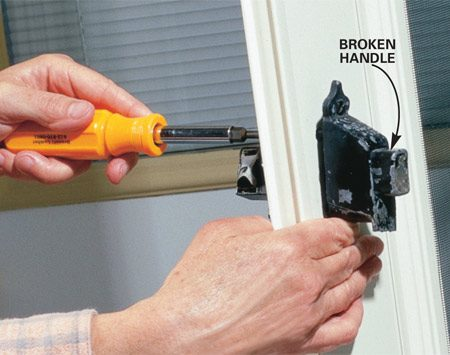 <b>Photo 1: Remove the old handle</b></br> Unscrew both interior latch-mounting screws, pull the interior and exterior handles apart and remove the center spindle. Discard the old handle.