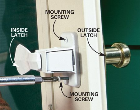 <b>Photo 3: Screw the inside and outside together</b></br> Slide the interior latch over the protruding spindle, and screw together the interior and exterior handles with the two mounting screws.