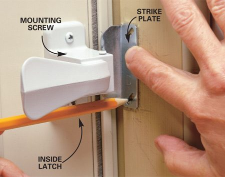 <b>Photo 4: Mount the strike</b></br> Hold the new strike plate in place with the door closed (have a helper push it tight from the outside). Mark the center of the mounting slots for maximum adjustability. Drill 3/32-in. pilot holes in the door jamb and screw down the new strike plate. (Use enclosed shims, if necessary.)