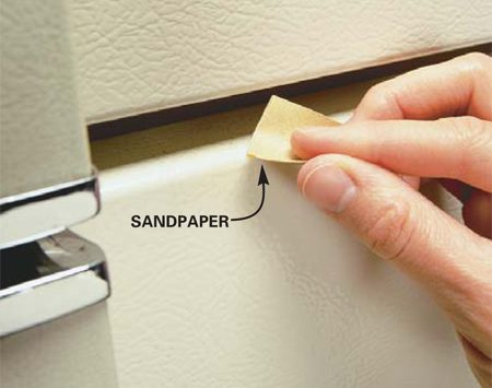 <b>Photo 2: Lightly sand</b></br> Lightly sand the area smooth with the sandpaper enclosed in the kit, and then buff it with a soft cloth.
