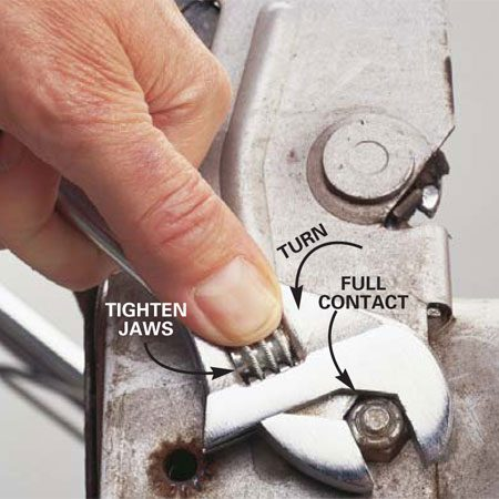 <b>Loosen stuck fasteners with an adjustable wrench</b><br/>If an adjustable wrench is your only tool, place it tight on the nut to loosen it.