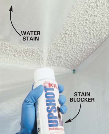 <b>Photo 3: Spray the area with primer</b></br> Spray stain-blocking primer over the water-damaged area and let it completely dry.