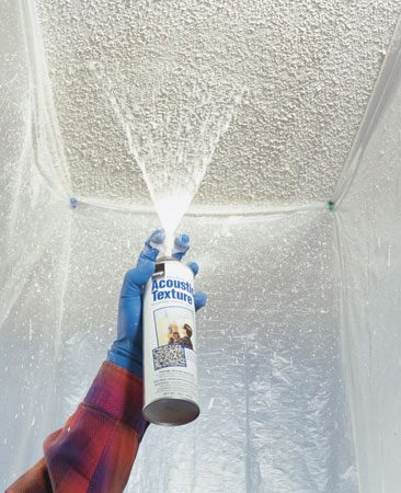 <b>Photo 4: Spray the texture</b></br> Shake the can of texture for a couple of minutes, and then screw the nozzle onto the valve stem. Hold the can 9 to 14 in. away from the ceiling. Squeeze the trigger with quick half-second bursts while sweeping the can over the damaged area. Allow the texture to dry for 24 hours before painting.
