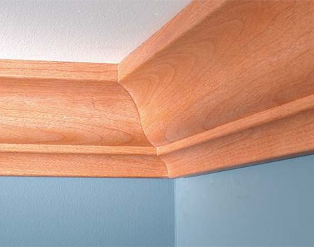 <b>Photo 11: Perfect crown molding</b></br> Measure and cut the end of the first crown molding square. Butt it into the corner. Don't nail within 16 in. of the corner. Cope the second piece of crown molding and file and sand it for a perfect fit.