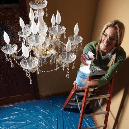 <b>Use chandelier cleaning spray</b><br/>Cleaning a chandelier the old-fashioned way&mdash;spraying and wiping each piece by hand&mdash;takes forever. And it doesn&#39;t help that you&#39;re standing on a ladder. Want an easier way? Try a spray-on chandelier cleaner. First spread a plastic tarp on the floor under the chandelier to catch the drips. Then turn off the light and spray the solution on the chandelier until liquid beads start to run (you&#39;ll use a lot of spray, but it beats wiping). The spray rinses off the dust. The solution that&#39;s left evaporates quickly and doesn&#39;t leave water spots. The spray works well on hanging crystals, but don&#39;t expect it to remove dust from crevices. Buy it for $10 from <a href='http://www.nancysilver.com'>nancysilver.com</a> or <a href='http://www.chandelierparts.com'>chandelierparts.com</a>.