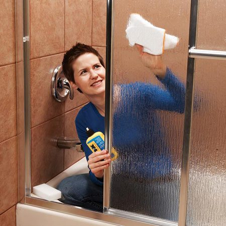 <b>Treat doors with water repellent product</b></br> <p>Keeping shower doors clean and streak free is a challenge—unless you know the pros' secrets. Start by cleaning any mold, mildew or streaks off the glass with a glass cleaner. Use a Mr. Clean Magic Eraser ($1) to get into the cracks in textured glass. Scrape off tough buildup with a razor blade. Dry the doors with a cloth.</p> <p>Treat the doors with a product like Aquapel ($8; <a href='http://www.autobodydepot.com'>autobodydepot.com</a>) or Rain-X ($5 at auto parts stores and home centers). These glass treatments form an invisible film on the glass to increase water repellency, causing water and soap to bead up and run off the glass. (Squeegee off the water after bathing to keep soap scum from building up again.) Spray or wipe on the glass treatment, then wipe it off with a microfiber cloth. Overspray won't harm surrounding surfaces. The products repel water for six months.</p>