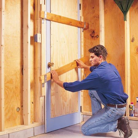 <b>Use plywood and 2x4s to add strength</b></br> <p>A flimsy old wooden garage entry door has weak center panels that can easily be kicked in by thieves. Adding a dead bolt won't solve that problem. A down-and-dirty way to beef up the door is to add a 1/2-in. plywood reinforcement panel and then bar it with 2x4s placed in bar-holder brackets.</p>