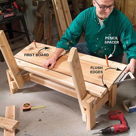 <b>Photo 8: Attach the seats</b></br> <p>Center the first 2x4 seat board over the leg assemblies and flush with the front ends of the seat supports. Screw it to the seat supports with two 3-in. deck screws spaced about 1 in. away from the edges. Line up the 2x10 with the first 2x4, space it about 5/16 in. away (the thickness of a carpenter's pencil) and screw it to the seat supports with two 3-in. deck screws. Repeat with the rear 2x4.</p>
