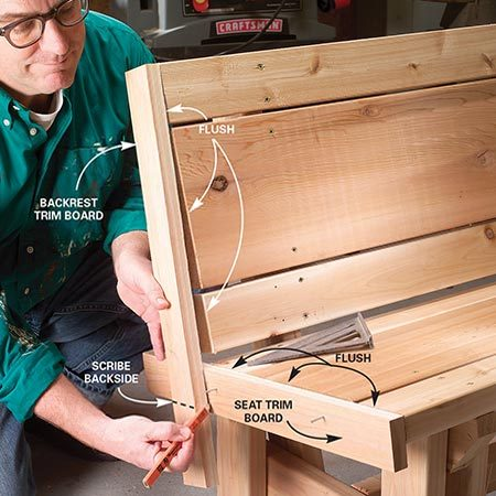 <b>Photo 11: Cut the seat trim boards to fit</b></br> <p>Tack the seat trim boards to the seat with the ends flush with the front and top. Scribe and cut the trim boards to fit. Nail the boards to the seat and backrest boards with 6d galvanized casing nails, keeping the nails 1 in. back from the seat edges.</p>