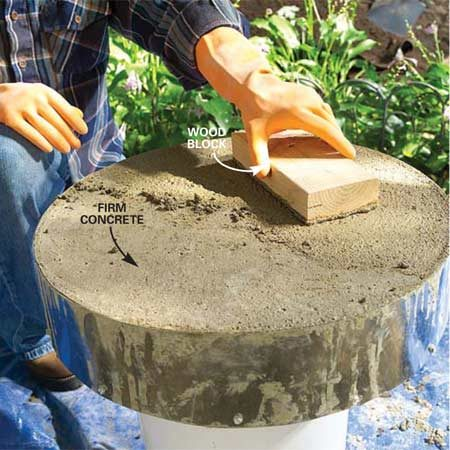 <b>Photo 8: Float the concrete</b></br> Let the concrete harden until the water on the surface has soaked in or evaporated and your thumb pressed into the surface just barely leaves an indentation. Then rub a block of wood in a circular motion over the surface to bring a layer of soupy cement and sand to the surface.