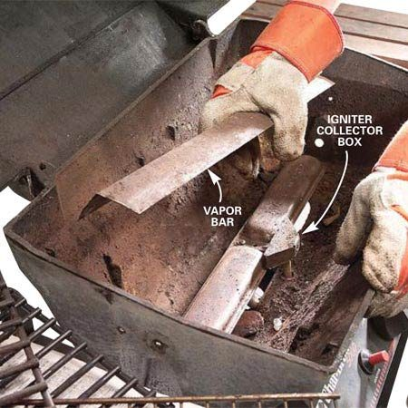 <b>Photo 2: Remove the flame bar</b></br> <p>Pull out the rock grate and set it aside. Lift off the vapor bar or flame spreader. Remove any lava rocks or briquettes that have fallen through the rock grate.</p>