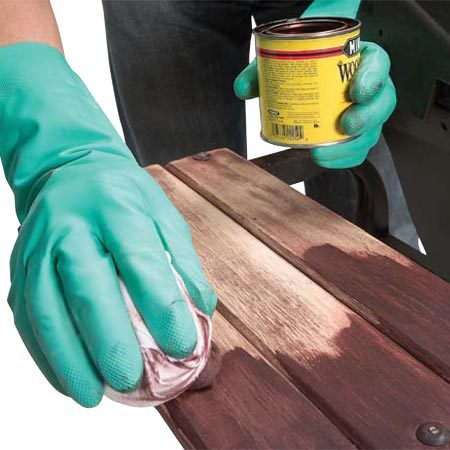 <b>Photo 13: Refinish the wood</b></br> Sand the wood slats with 100-grit sandpaper. Stain the wood to restore the color and seal with Danish oil or linseed oil.