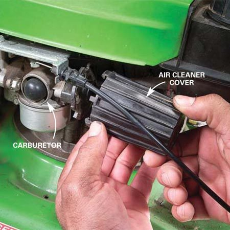 <b>Photo 8: Remove air filter cover</b></br> For pleated paper air filters: Locate the air filter near the carburetor. Unscrew, unsnap or twist off the cover to remove the old filter.