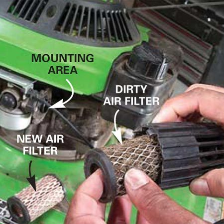 <b>Photo 9: Replace air filter</b></br> Remove the old air filter and replace it if it's dirty. Wipe grass and dirt from the filter cover and the mounting area with a clean cloth before installing the new filter. Be careful not to let dirt fall into the carburetor.