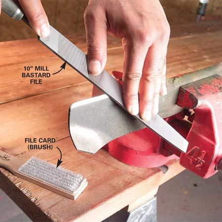 <b>Photo 14: Sharpen the cutting blade with a metal file</b></br> File previously ground or slightly dulled blades with a 10-in. mill bastard file to hone the edge. Align the file with the angle of the blade and push down across the blade. You should feel the teeth cutting the metal. Maintain the same angle throughout the stroke. Files cut only on the push stroke. Use a file card to clean built-up metal from the file's teeth.