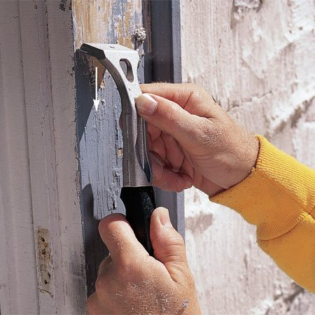 <b>Photo 2: Keep your scraper sharp</b></br> Pull down firmly with a sharp scraper to remove loose paint. Remember, you don't need to remove all the paint, just the stuff that flakes away with the scraper. Keep your scrapers sharp with a fine file.  <strong>Tip:</strong> Don't scrape wet wood. You'll tear away the fibers and dig deep gouges into the wood.