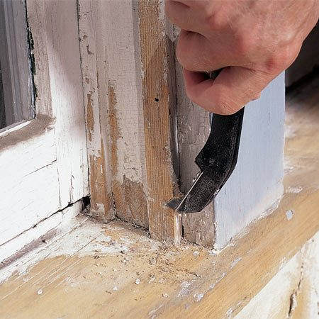 <b>Photo 3: Use small scrapers too</b></br> Get into tight areas with a small 1-in. scraper. Heavy buildup of paint in corners will eventually crack and let moisture in. Scrape and cut excess paint out of the corners with a sharp putty knife.