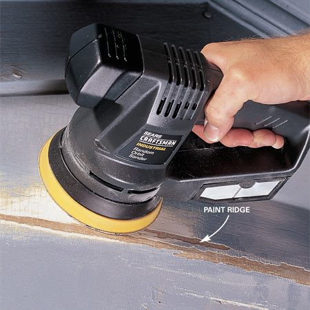 <b>Photo 1: Smooth paint edges</b></br> Feather the edge of your scraped areas with a power sander to get rid of sharp edges. These ridges can break the finished paint surface later and allow moisture to get behind the paint. After sanding (use 80 to 100 grit), use a dry brush to whisk away any surface dust, especially on horizontal surfaces like windowsills.