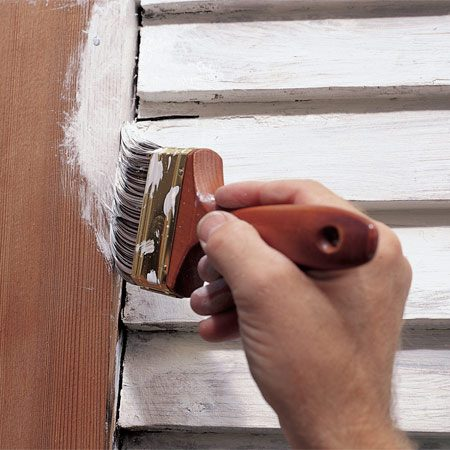 <b>Photo 2: Prime all bare wood</b></br> Work the primer into cracks and especially where trim pieces meet siding. Even out the primer with long brush strokes and check for drips. Remember to work the primer under the siding laps and into tight spaces and hard-to-see spots. Surfaces that still have old paint that's adhering well don't need a primer.