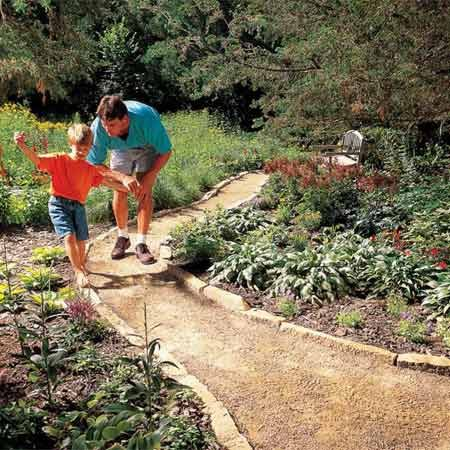 <b>Photo 1: Gravel paths are simple to build</b></br> Gravel paths are the easiest to build. Although these paths look informal, a limestone border like this one really dresses them up.