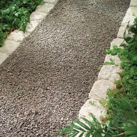 <b>Photo 3:  Stone edging</b></br> Tumbled stone and  other stone borders require fitting, but they look the most  natural.