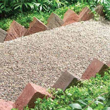 <b>Photo 4: Brick edging</b></br> Bricks fit together easily and form highly traditional border  patterns.