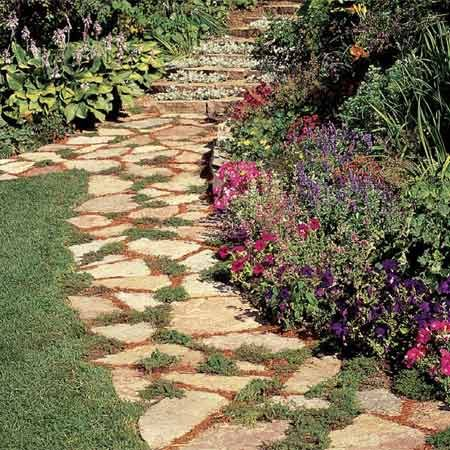 <b>Photo 1: Stone pathway</b></br> Stone paths are highly decorative and easy to lay. You fit them like a long, freeform puzzle.