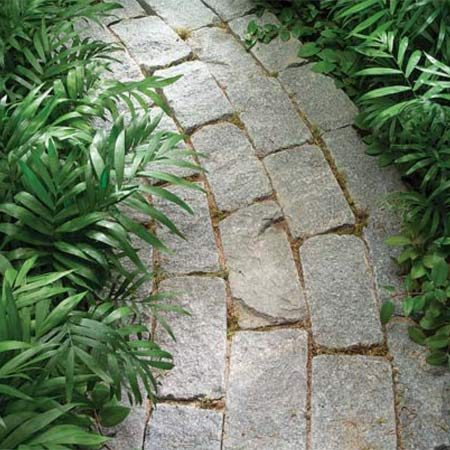 <b>Photo 4: Stone pavers</b></br> Stone  pavers are cut from natural stone and are a  uniform size. They often have rough faces.