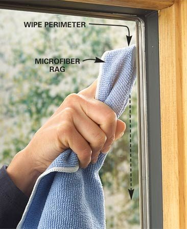 <b>Photo 7: Wipe off excess water</b></br> Use the rag in your pocket to wipe up excess water along the bottom edge of the window. Then poke your finger into a dry spot on a separate lint-free rag and run it around the perimeter of the window to remove any remaining suds. Wipe off any streaks using a clean area of the lint-free rag. Change rags when you can't find any fresh, clean areas.
