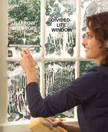 <b>Photo 8: Divided-lite window solution</b></br> Wash  divided-lite windows with a sponge and a small squeegee. If you can't find a  small enough squeegee, you can cut off a larger one to fit your glass size.  Scrub the glass with a wrungout sponge. Then use the tip of the squeegee to  clear a narrow strip at the top (same technique as Photo 3). Pull the squeegee  down and wipe the perimeter.