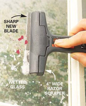 <b>Photo 11: The razor blade solution</b></br> Remove paint specks and labels with a razor blade mounted in a holder. Always use a new blade to avoid scratching the glass. Wet the window first and push the blade across once. Rinse the blade and repeat on the next section to avoid trapping debris under the blade that could scratch the glass. Don't use a razor blade on tempered glass.