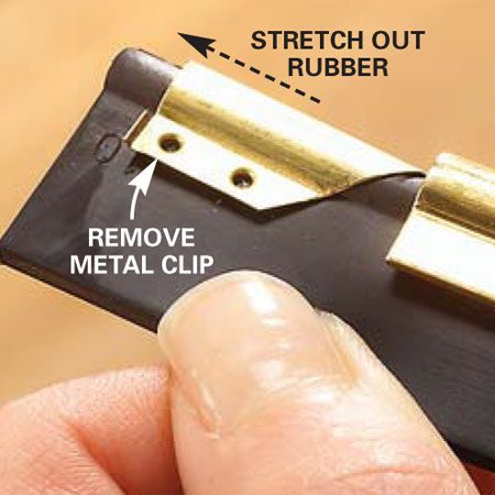 <b>Photo 9: Remove the old blade</b></br> Grab the end of the blade and stretch it out to expose the metal clip. Slide the clip off. Then slide the blade out the opposite end. Blades without clips are held by screws and the clamp on the handle.